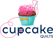 Logo of thread-topped cupcake  for Cupcake Quilts in Texas.