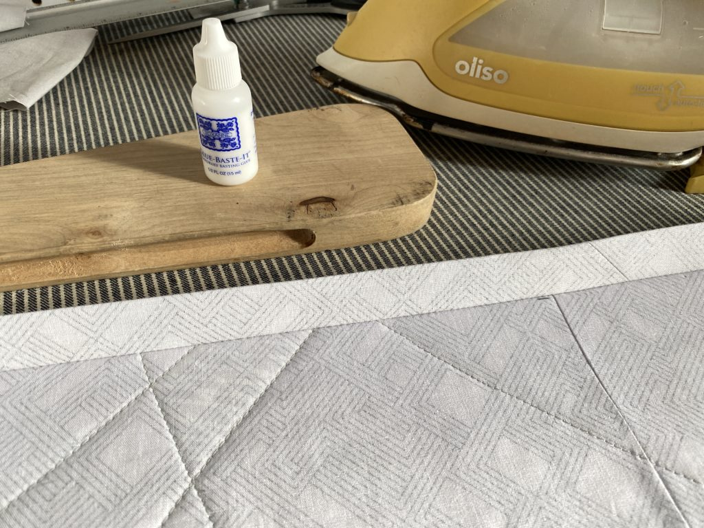 Glue, iron, clapper and quilt binding